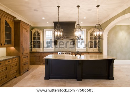 opulent kitchen in complementary colors with granite island - stock photo