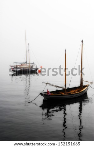 Or rather boats in the fog - in the harbor at Halifax, Nova Scotia, Canada. - stock photo