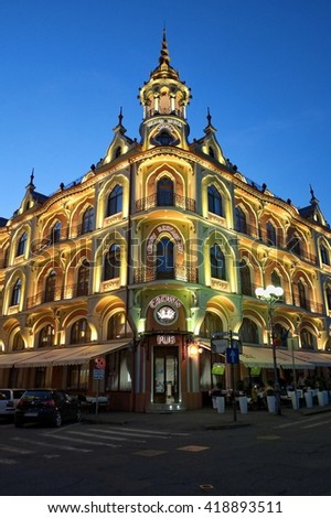 ORADEA, ROMANIA - AUGUST 01, 2015:  Grand hotel Astoria by Night was realized by Sztarill Ferenc in 1902 in Jugendstil with gothic impressions