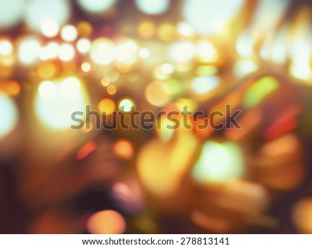 Orange abstract background holidays lights in motion blur image - stock photo
