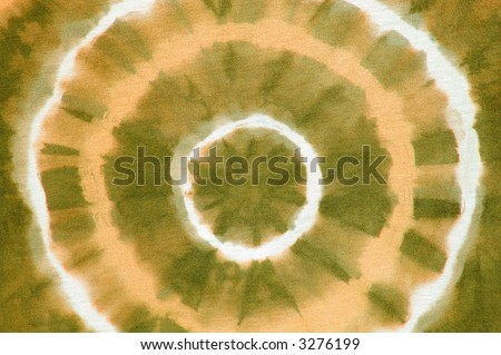 orange abstract on tie dyed cotton fabric 4 of 5 colors - stock photo