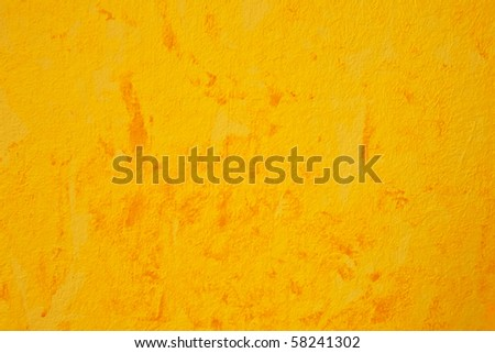 Orange abstract pattern over a yellow background color. - stock photo