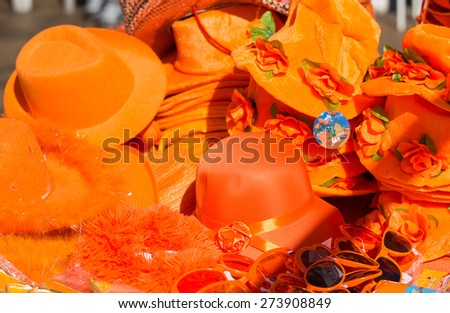 Orange accessory for sale at the celebration of King's day - Koningsdag - to celebrate King Willem's birthday. - stock photo