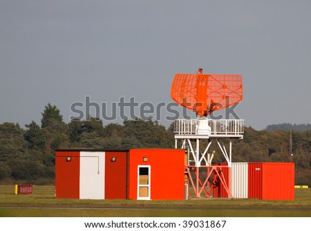 Orange airport radar antena at a provincial English airport