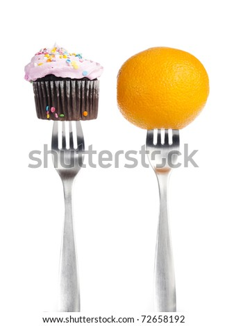 orange and a cupcake on forks