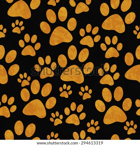 Orange and Black Dog Paw Prints Tile Pattern Repeat Background that is seamless and repeats - stock photo