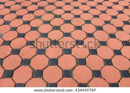 Orange and black paving stone - stock photo