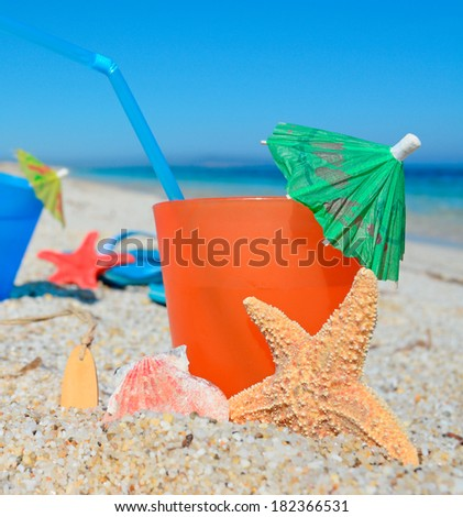 Flipflops sunscreen spray coconut cocktail on stock photo for Orange and blue cocktails