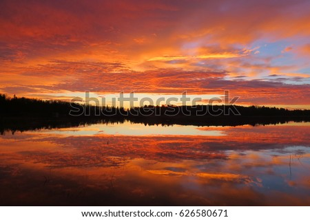 Orange and Blue Lake Sunrise with Reflections, Silhouetted Trees in Horizon ~ Nevis, Minnesota