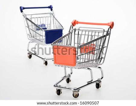 orange and blue shopping cart on white - stock photo