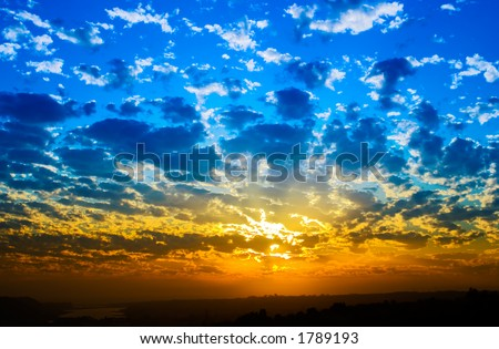Orange And Blue Sunset On Beach - stock photo