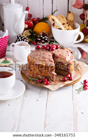 Orange and cranberry christmas cake with cinnamon glaze - stock photo