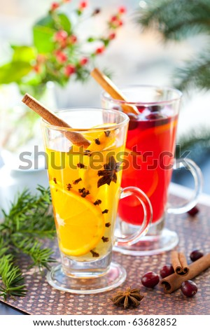 Orange and cranberry  punch with orange slices and spices.Hot drinks for winter and Christmas - stock photo