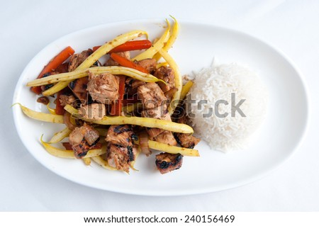 orange and ginger chicken thigh stir fry with farm fresh vegetables and jasmine rice - stock photo