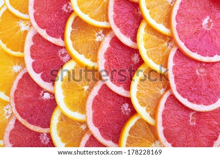 Orange and grapefruit rings as a background  - stock photo