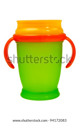 Orange and green baby plastic cup with handles isolated over white background. - stock photo