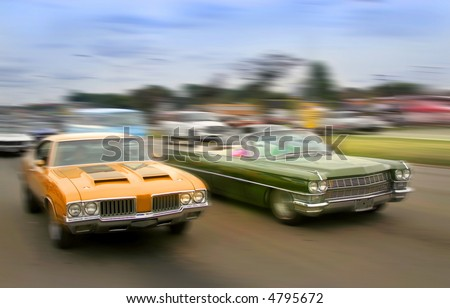 Orange and green color muscle cars cruising on historic woodward avenue. - stock photo