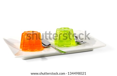 Orange and green Jelly on dessert plate  isolated on a white background. - stock photo