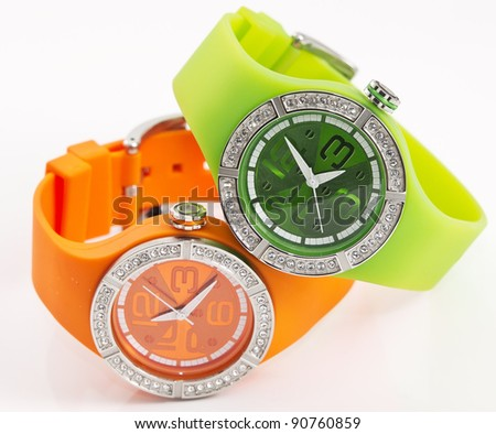 orange and green watches - stock photo