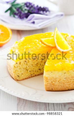 Orange and lavender cake with orange jelly, selective focus - stock photo