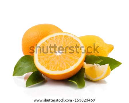 Orange and lemon with leaves - stock photo