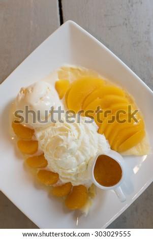 Orange and Peach Crepe served with Vanilla Ice Cream - stock photo