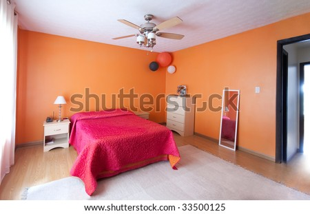 Orange and pink bedroom - stock photo