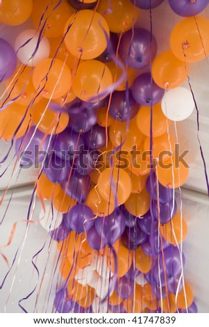 orange and purple balloons in the ceiling - stock photo