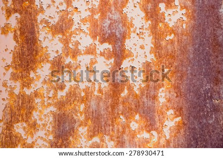 Orange and purple rusty old textured wall - stock photo