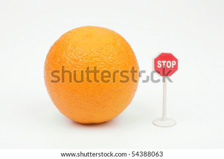 Orange and sign stop on a white background - stock photo