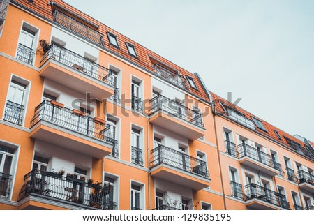 orange and typical berlin buildings in low angle view