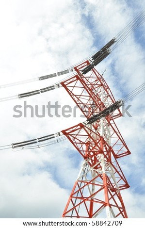 orange and white electric power tower with lines. - stock photo