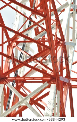 Orange and white power utility tower for electricity. Orange and white clean and new. - stock photo