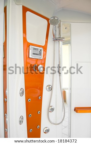 Orange and white shower in the bathroom