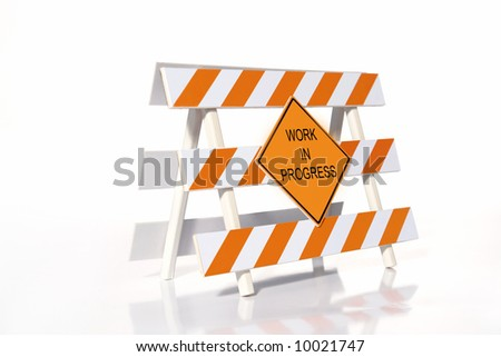 Orange and white striped road construction barrier with Work in Progress sign over white background - stock photo