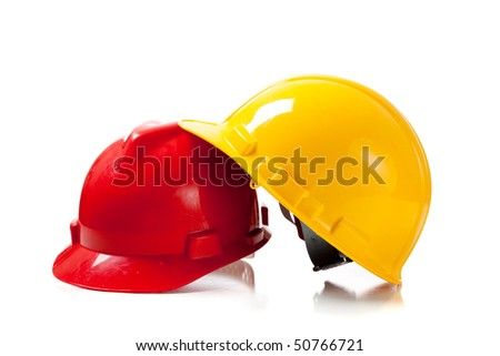 Orange and yellow hardhat on a white background with copy space - stock photo