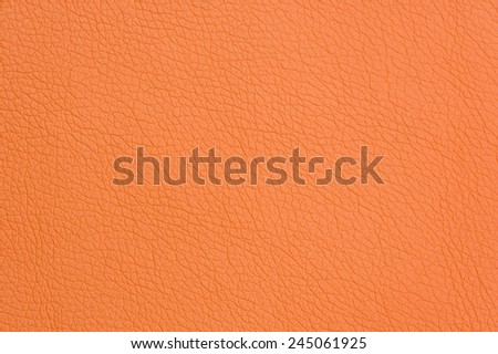 Orange Artificial Leather Background Texture Close-Up  - stock photo