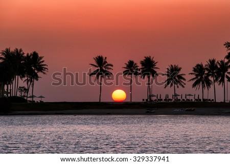 Orange background durin sunset at Laguna in Phuket - stock photo
