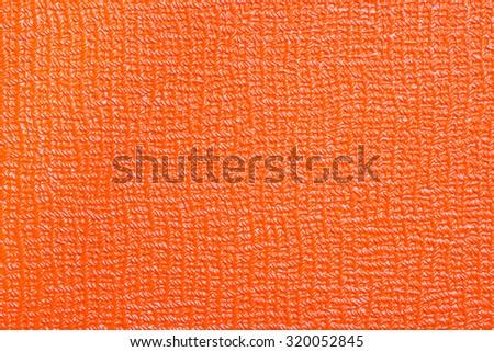 orange background material tolex closeup - stock photo