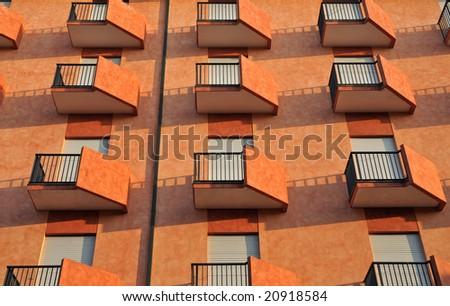 Orange balconies - stock photo