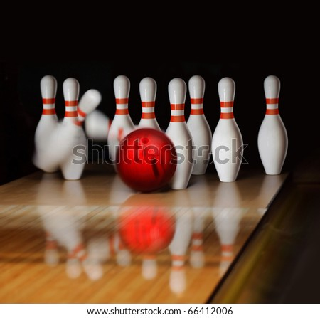 orange ball does strike on tenpin bowling in skittle-ground - stock photo