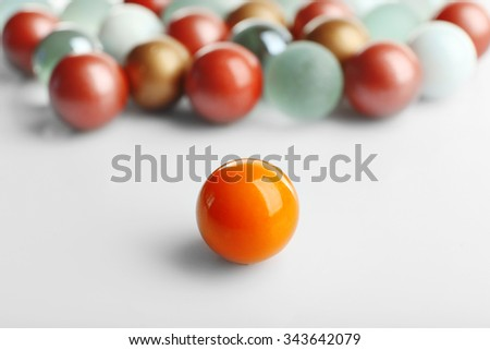 Orange ball opposite others, isolated on white, individuality concept - stock photo