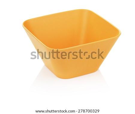 orange bamboo bowl, isolated on white background - stock photo