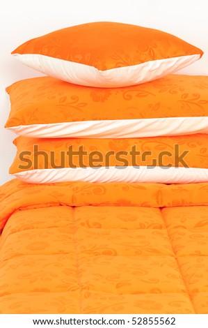 Orange bedding spreads. - stock photo