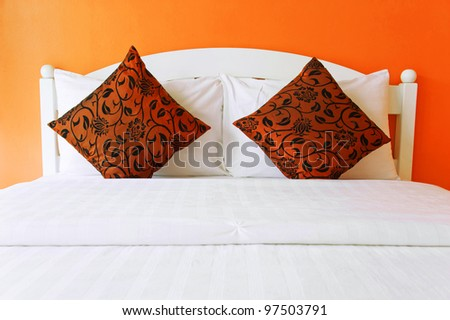 Orange bedroom in a modern house - home interiors. - stock photo