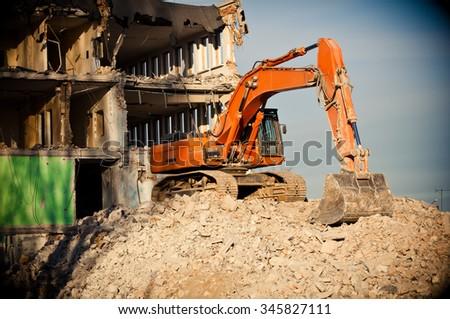 orange big digger destroys building - stock photo