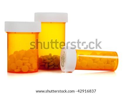 Orange bill bottles on a white background - stock photo