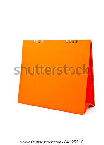 orange blank desktop calendar isolated on white background - stock photo