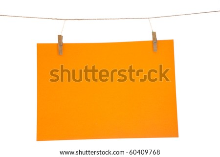 Orange blank paper sheet on a clothes line. Isolated on white background. - stock photo