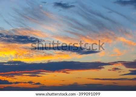 orange, blue and yellow colors sunset sky  - stock photo